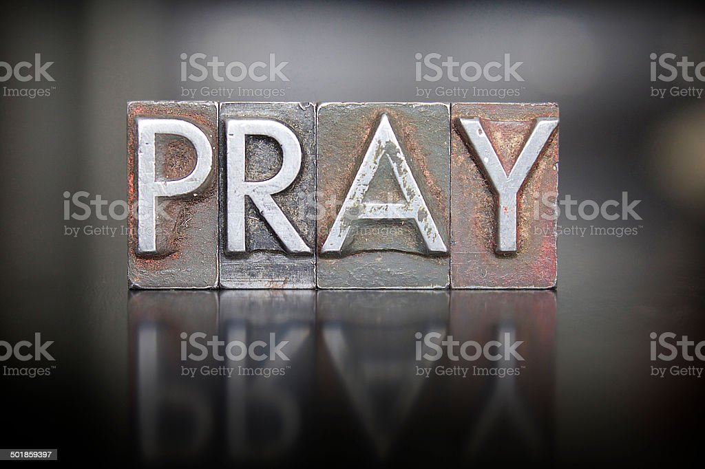 Pray Letterpress stock photo