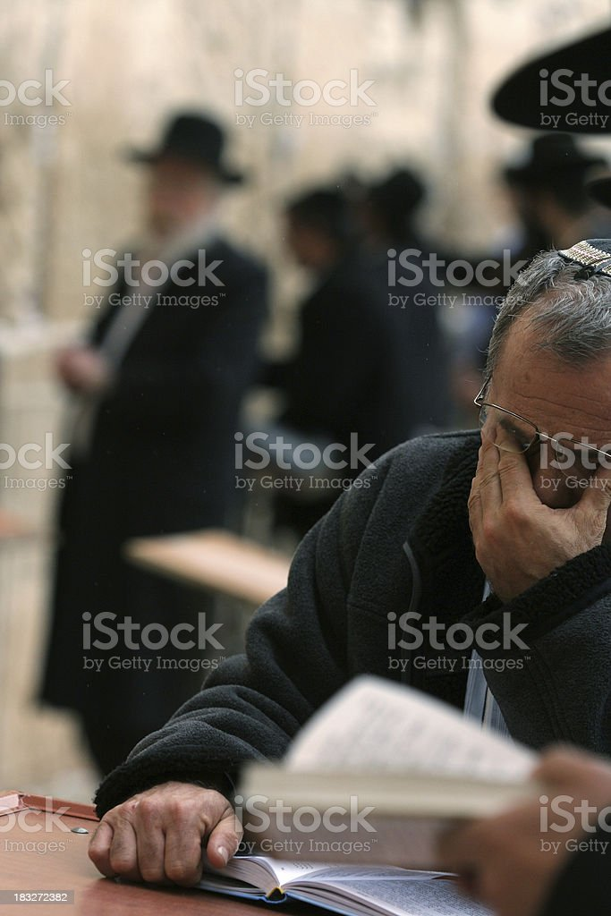 Pray neare the wall off crying stock photo
