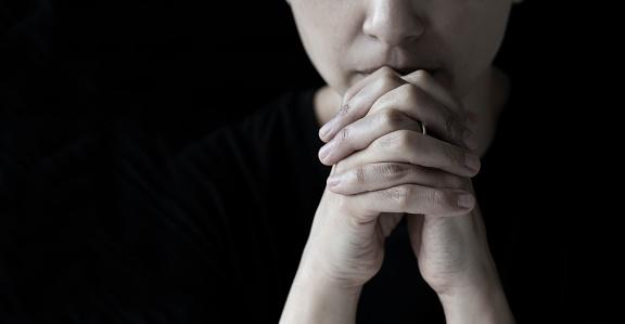 Woman is praying.