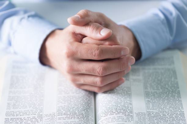 Pray. Male hands and  holy bible on background clergy stock pictures, royalty-free photos & images