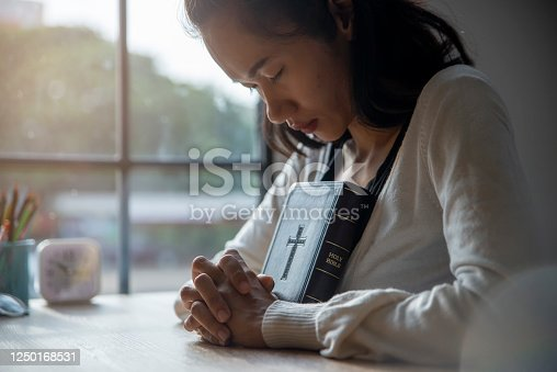 istock Prayer and bible in New Normal concept 1250168531