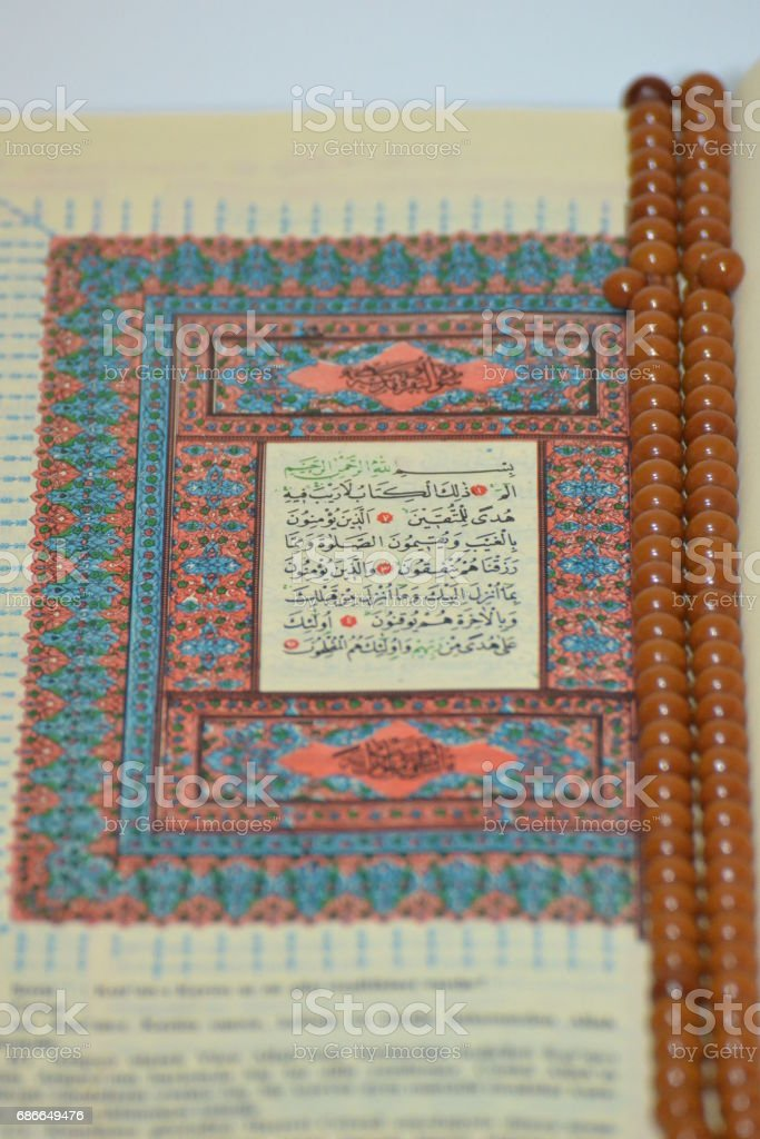 Rosary with The Holy Quran royalty-free stock photo