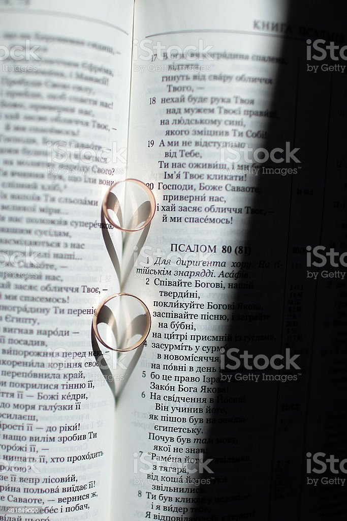Prayer book and wedding rings stock photo