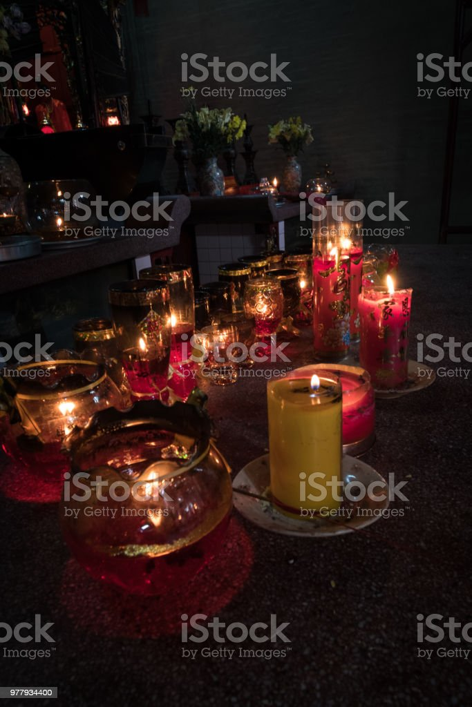 Prayer candles in temple stock photo