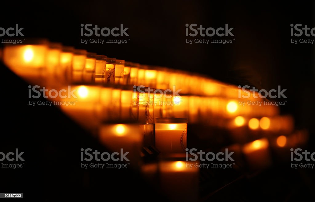 Prayer candles in the catholic cathedral royalty-free stock photo
