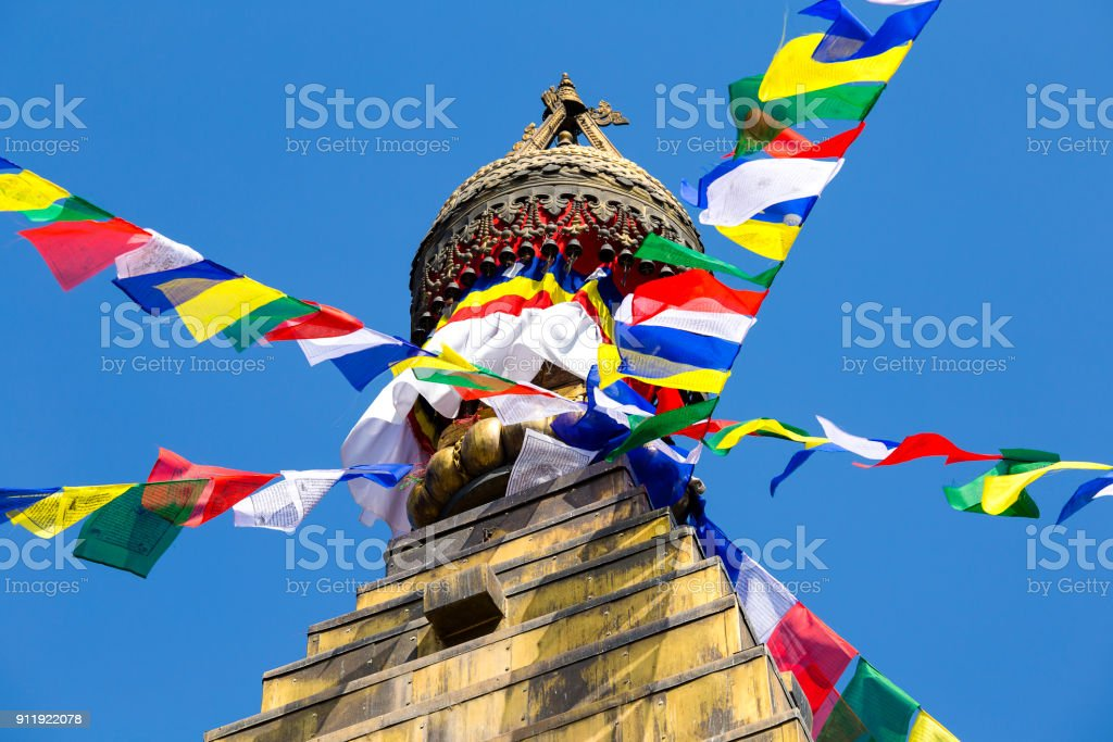Prayer colorful flags flying from the Buddhist Stupa, a place of holy worship. Buddhist Temple in the Kathmandu valley, Nepal stock photo