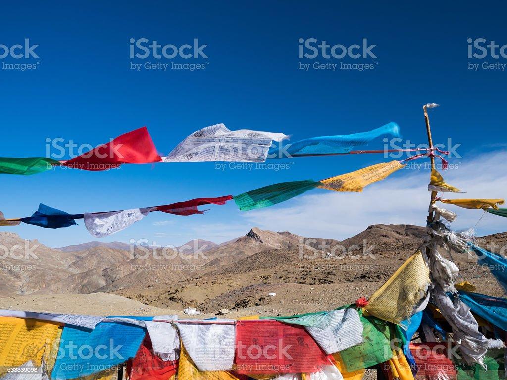Prayer flag and Mountain in Tibet stock photo