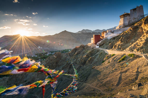 Prayer flag in Tsemo castle with beautiful mountain snow landscape background in Leh Ladakh stock photo