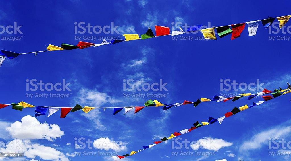 Prayer flags against dark blue sky stock photo