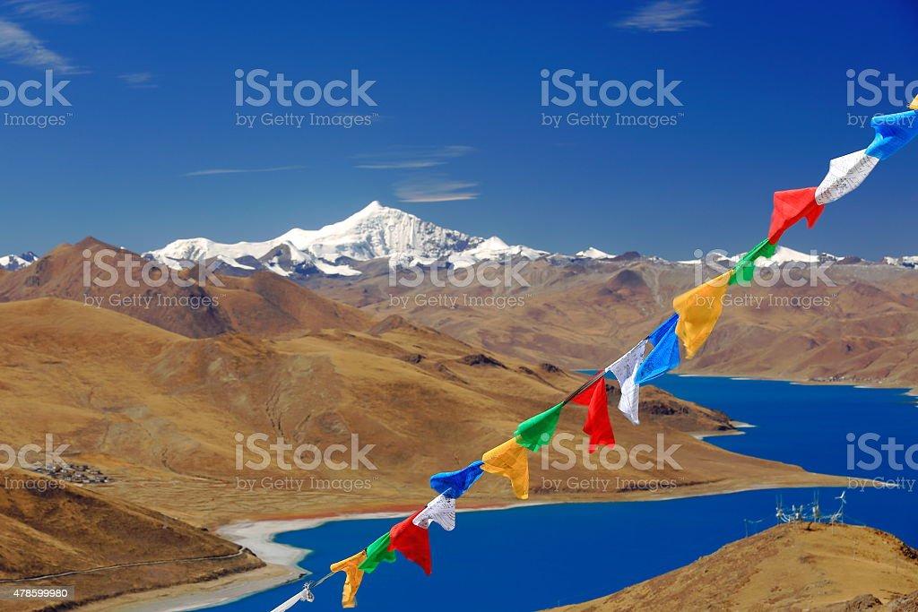 Prayer flags crossing YamdrokTso-Lake. Kamba La-pass. Tibet. 1539 stock photo