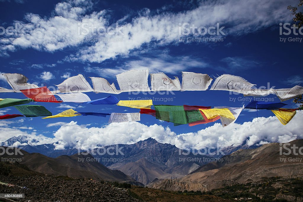 Prayer Flags fluttering high up in the mountains. stock photo