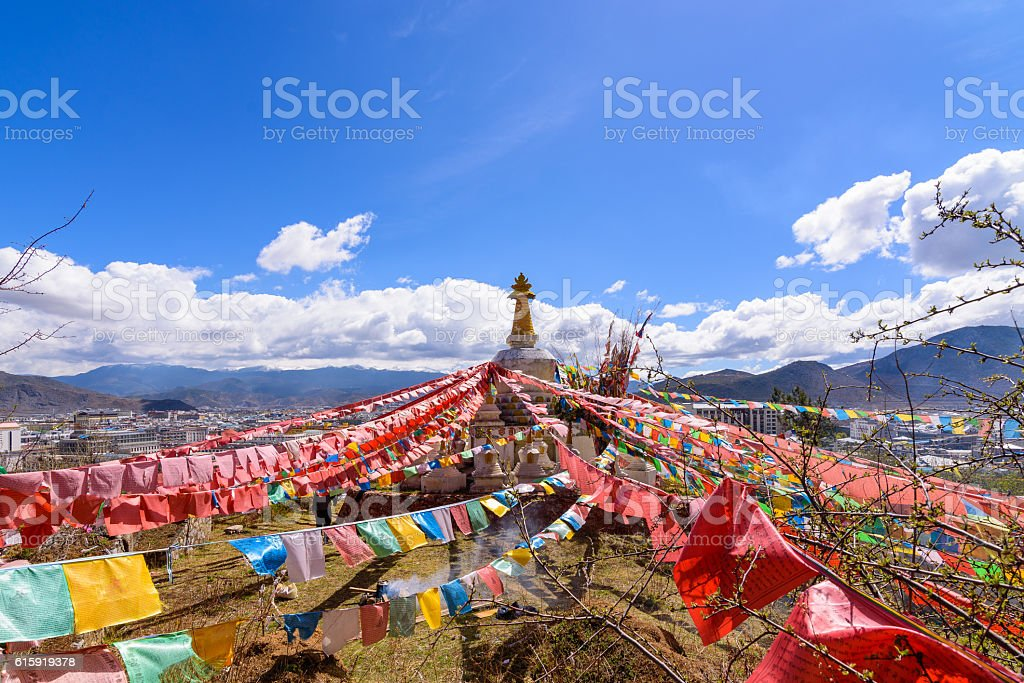 Prayer flags flying on the Pagoda or Stupa stock photo