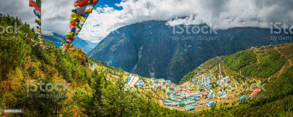 Prayer flags flying over Namche Bazaar Sherpa village Himalayas Nepal stock photo