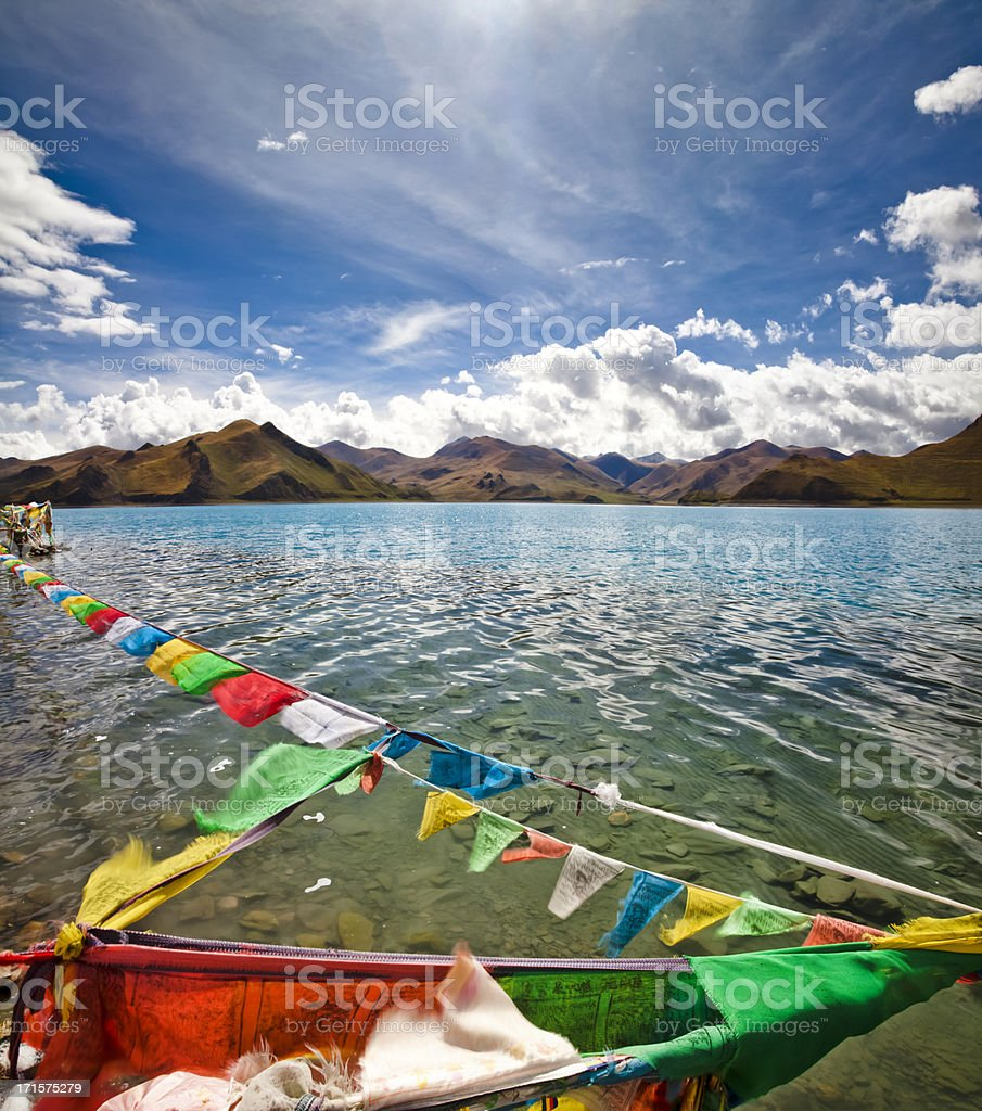 Prayer flags flying over the Yamdrok Lake stock photo