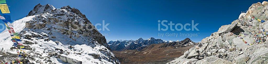 Prayer flags Himalayan mountain peaks Cho La Everest NP Nepal royalty-free stock photo