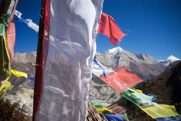 Prayer flags in the Himalaya mountains, Annapurna region, Nepal stock photo