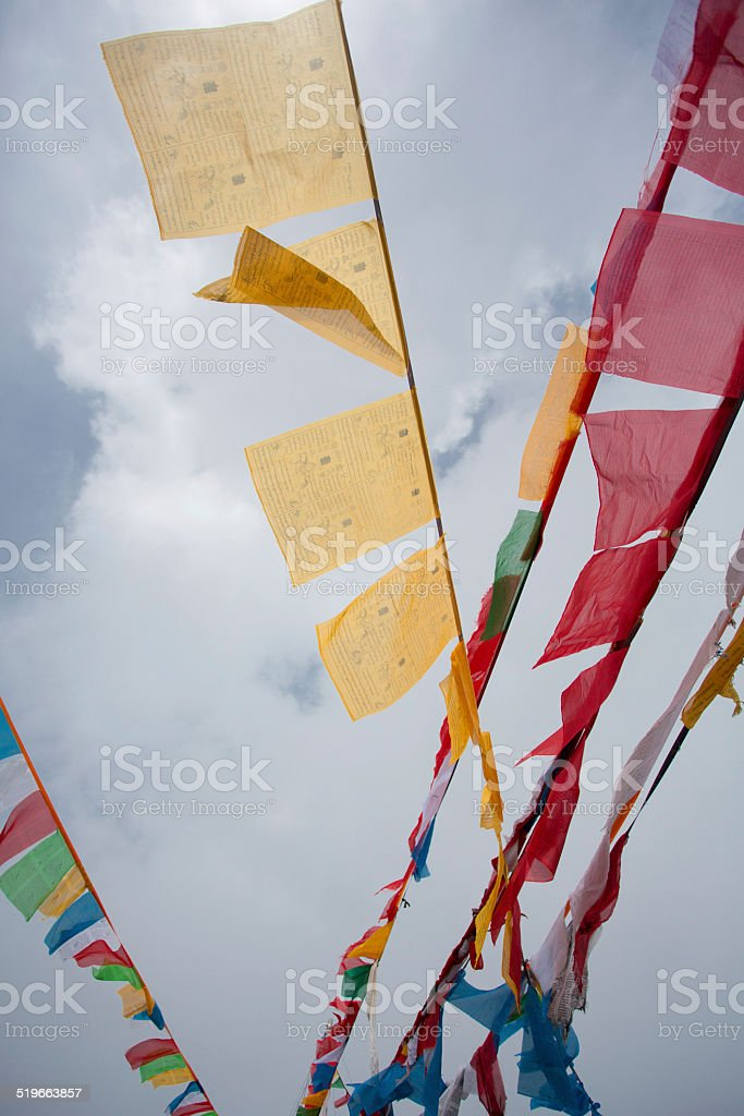 Prayer Flags with sky in the background stock photo