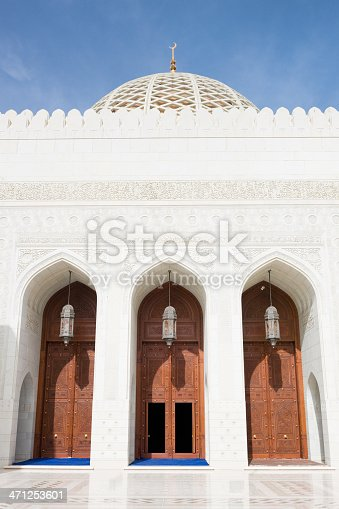 Large wooden doors with old lamps. The Entrance into the Prayer Hall of  Sultan Qaboos Grand Mosque Muscat, Oman, Middle East, Arabia.