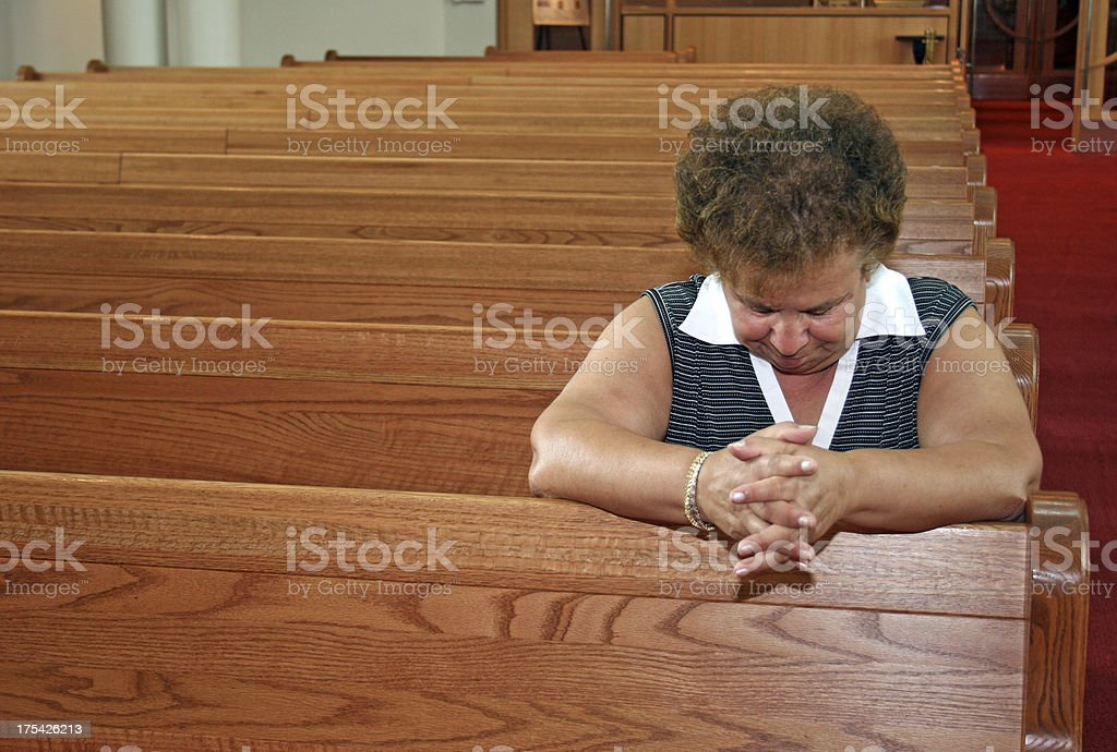 Prayer in Pew royalty-free stock photo