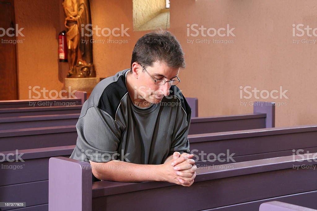 prayer in the church royalty-free stock photo