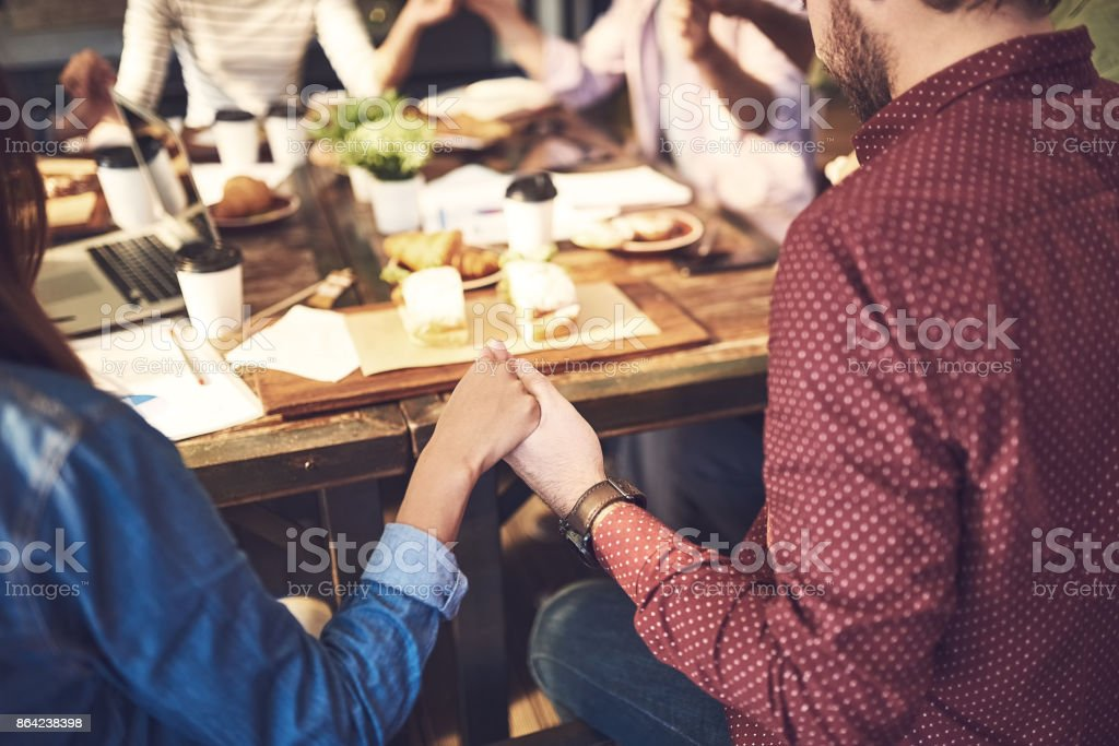 Prayer is a good way to start a meeting royalty-free stock photo