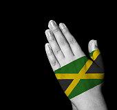 Prayer - Jamaica flag painted on hands