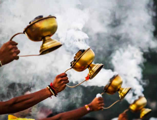 prayer lamps india Rishikesh ganges offering prayers stock photo