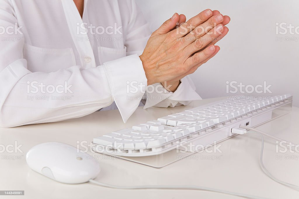 Prayer over white mouse and keyboard royalty-free stock photo