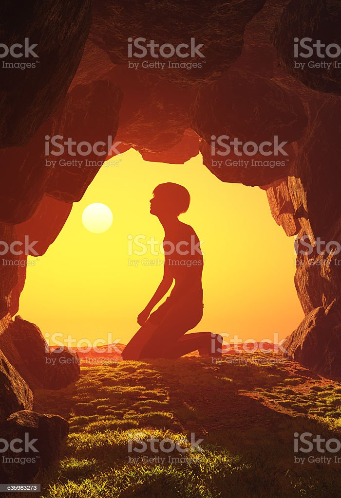 Boy praying in the cave.