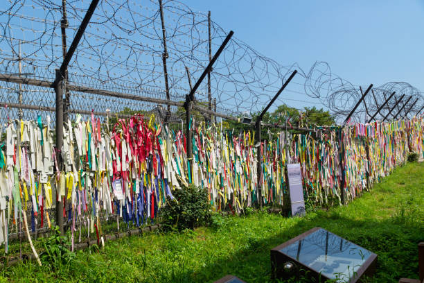 Prayer ribbons tied to the fence left by visitors wishing peace and unification for North and South Korea at the freedom bridge, DMZ, Gyeonggi, Republic of Korea stock photo