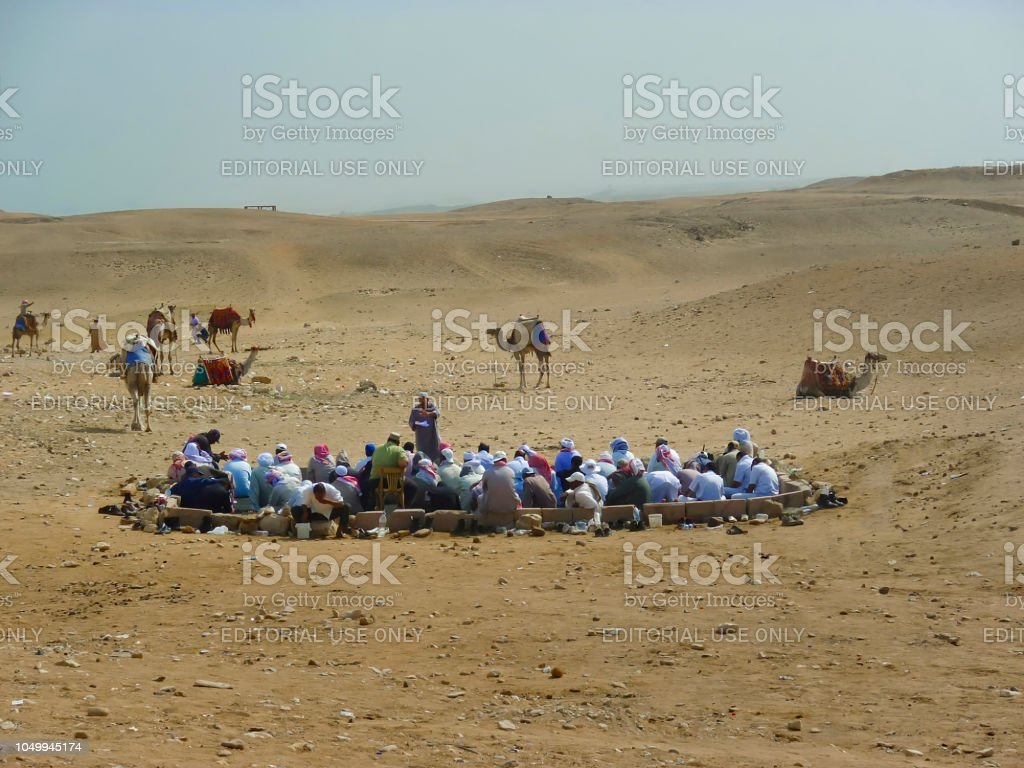 Prayer Time in The Sahara Desert. Editorial image. stock photo