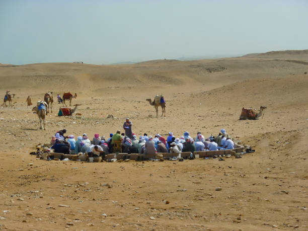 Prayer Time in The Sahara Desert. Editorial image. stock photo