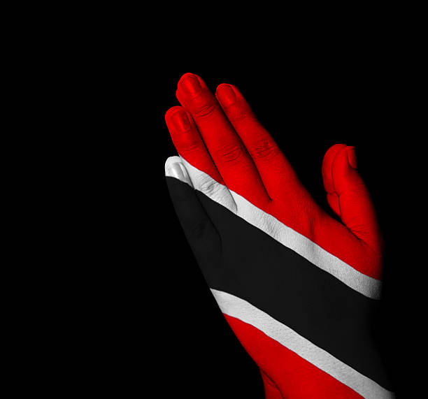 Prayer - Trinidad and Tobago flag painted on hands stock photo