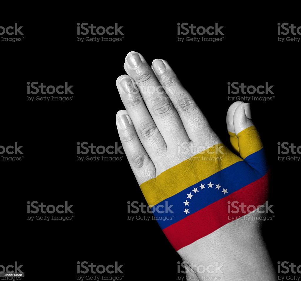 Prayer - Venezuela flag painted on hands stock photo