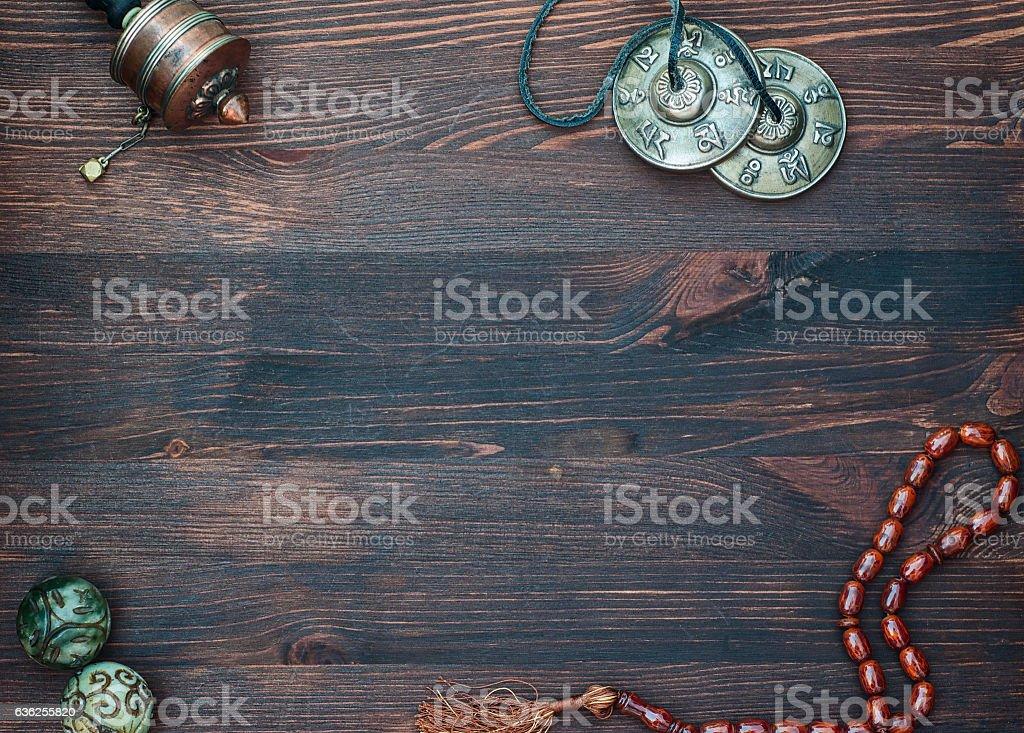 Prayer wheel, prayer beads, magic balls and brass plates stock photo