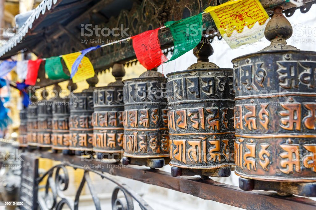 Prayer wheels and prayer flags stock photo