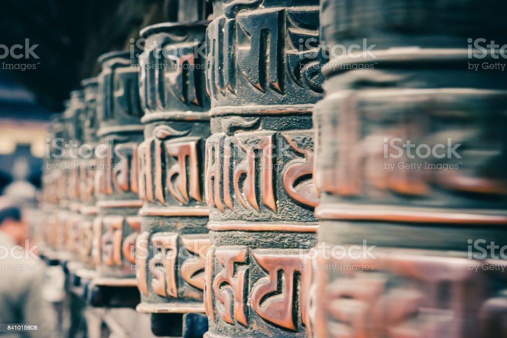 Prayer wheels at  the Swayambunath Temple, Kathmandu, Nepal stock photo