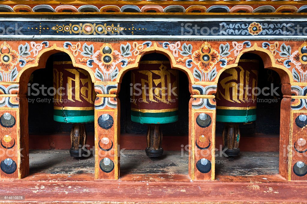 Prayer wheels inside Rinpun Dzong in Paro, Bhutan stock photo