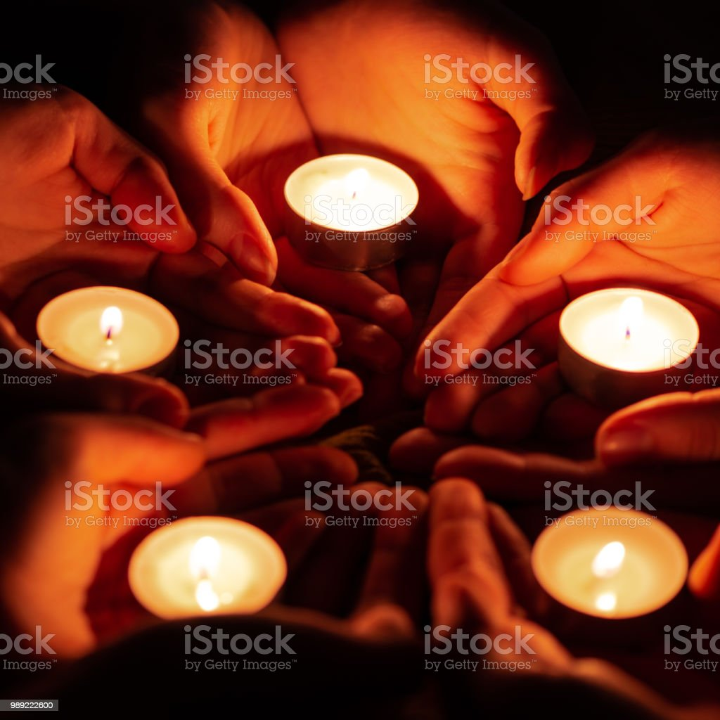 Prayer With Candles In Hands Stock Photo & More Pictures of Black Background