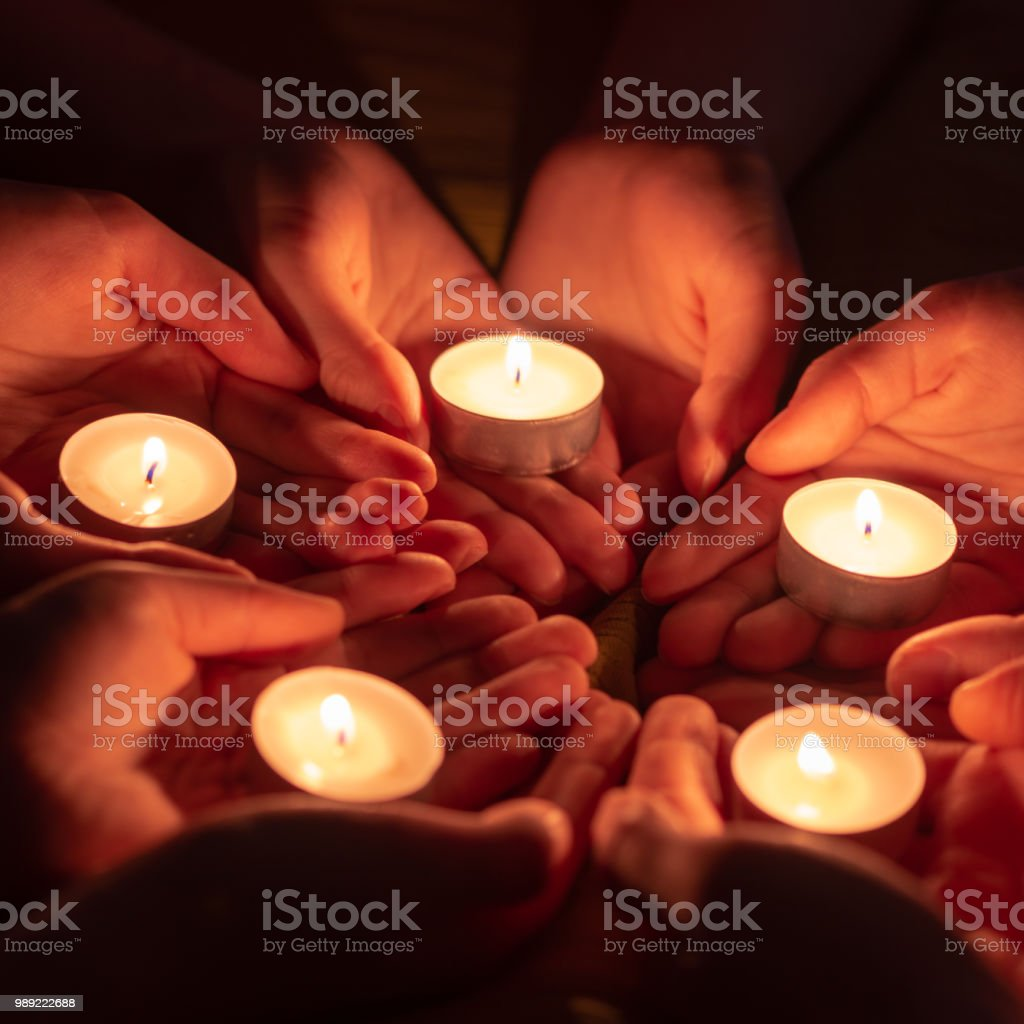 Prayer With Candles In Hands Stock Photo & More Pictures of Black