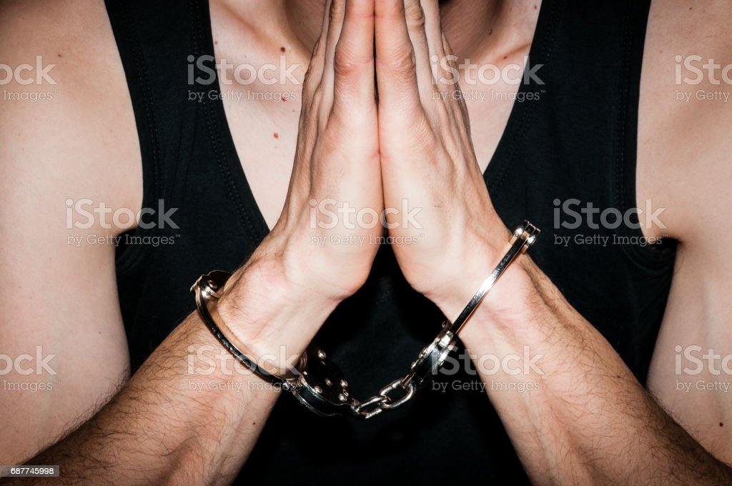 Image result for praying while handcuffed