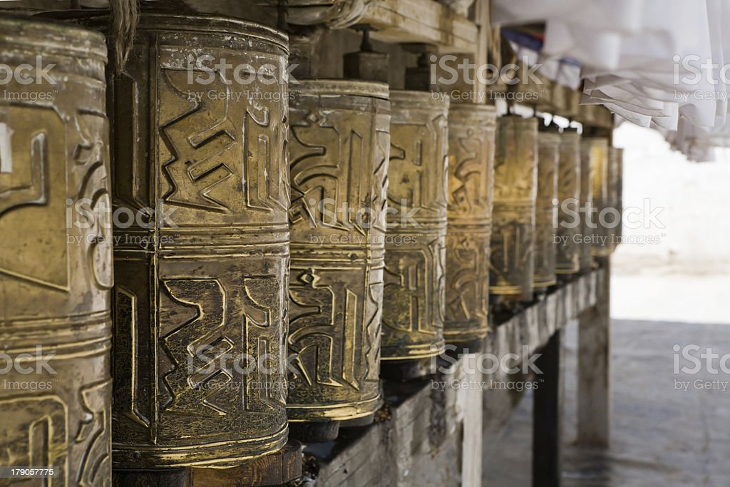 Prayers wheels  in monastery royalty-free stock photo