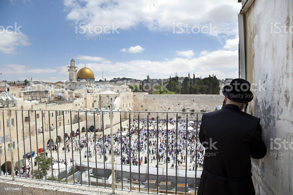 Praying Above the Western Wall royalty-free stock photo