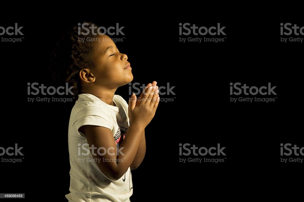 Praying African American Girl stock photo