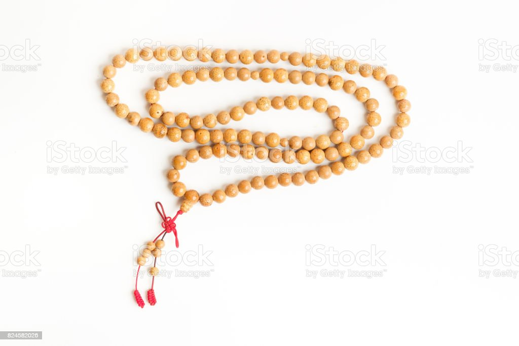 Praying and reciting wooden beads stock photo