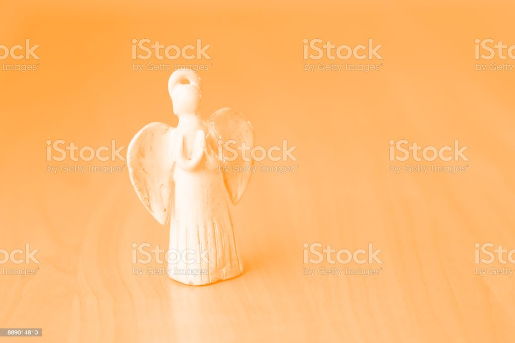 Praying angel ceramic doll. stock photo