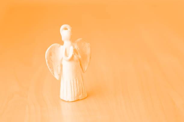 Praying angel ceramic doll. stock photo