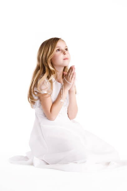 praying angel - religious celebration stock photos and pictures