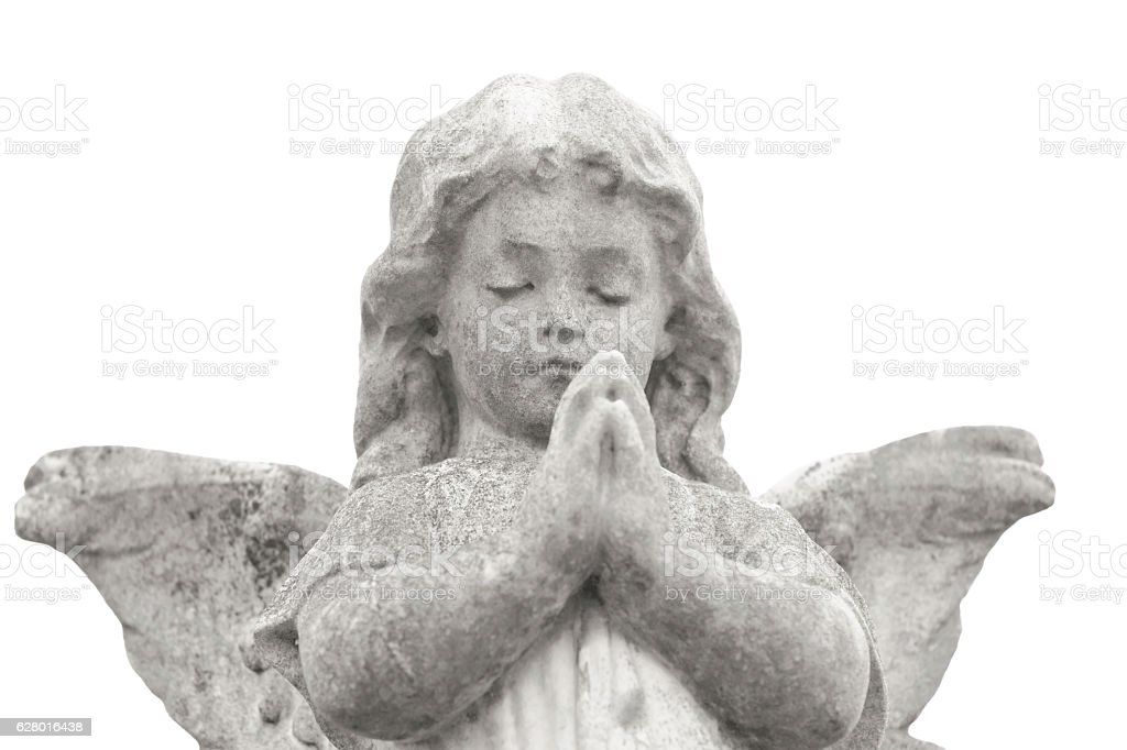 Praying angel, weathered old statue of little angel, copy space stock photo