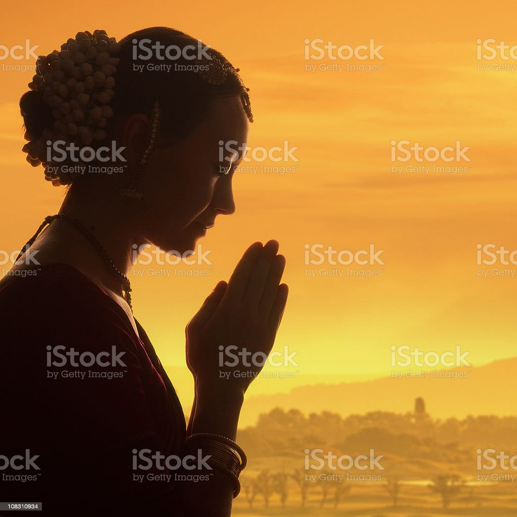 praying at dawn stock photo